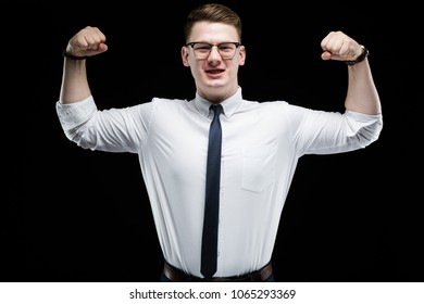Portrait of confident handsome elegant responsible businessman showing muscles on black background