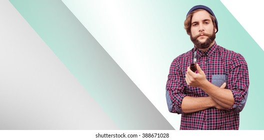 Portrait of confident hipster holding smoking pipe against green vignette