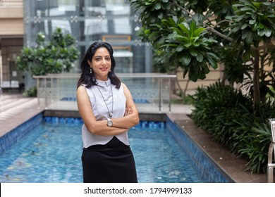 Portrait of confident Indian business woman in corporate building. Female in smart formal business attire