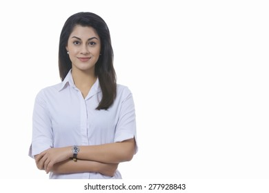 Portrait of confident Indian businesswoman against white background