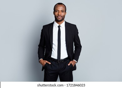 Portrait of confident intelligent afro american man marketer representative put hands pocket pants trousers ready decide successful solutions isolated over gray color background