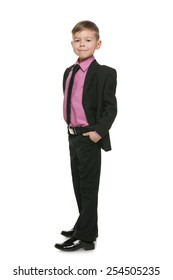 A portrait of a confident little boy in a black suit on the white background