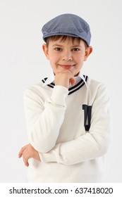 Portrait of confident little boy in cool hat looking at camera.