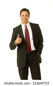 Portrait of a confident looking business executive giving the thumbs up sign