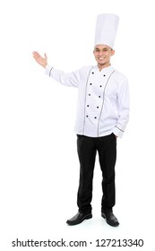 Portrait of confident male chef smiling presenting blank space for your text