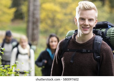 Portrait Of Confident Male Hiker In Forest