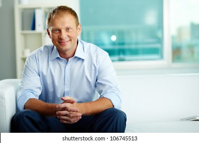 Portrait of confident man sitting in office