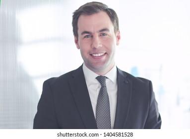 Portrait of a confident mature businessman standing outside.