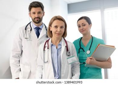 Portrait of confident medical professional team at hospital