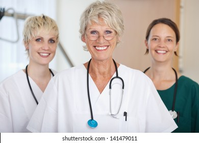 Portrait of confident medical team of female doctors smiling together in clinic