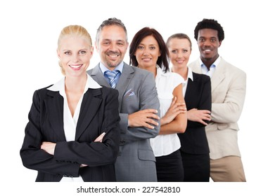 Portrait of confident multiethnic businesspeople standing arms crossed over white background