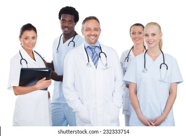 Portrait of confident multiethnic medical team standing over white background
