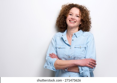 Portrait of a confident older woman smiling with arms crossed