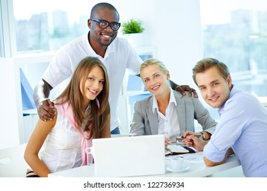 Portrait of confident partners looking at camera at workplace