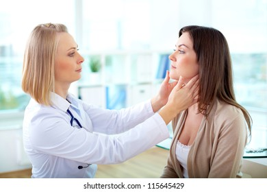Portrait of confident practitioner examining patient
