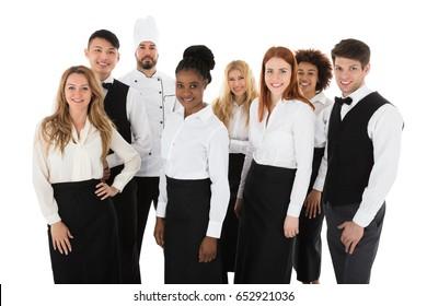 Portrait Of Confident Restaurant Staff Standing Against White Background