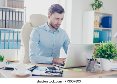 Portrait of confident serious concentrated hardworking busy wearing formal clothes system administrator, he is updating software on modern laptop in office
