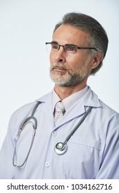 Portrait of confident serious general practitioner