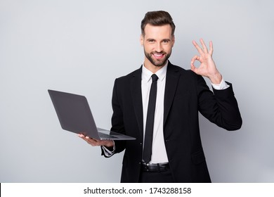 Portrait of confident smart entrepreneur man hold computer work project approve show okay sign wear formalwear outfit isolated over grey color background
