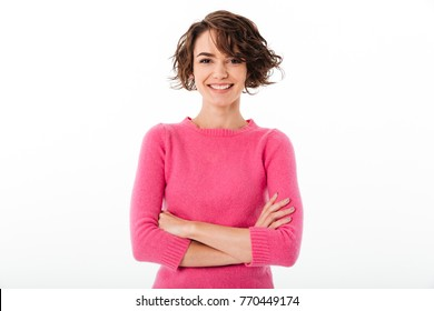 Portrait of a confident smiling girl standing with arms folded and looking at camera isolated over white background