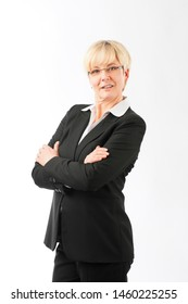 Portrait of confident smiling mature businesswoman standing against white background