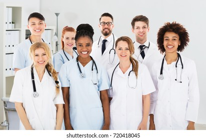 Portrait Of Confident Smiling Multi Ethnic Male And Female Doctors In Clinic