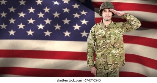 Portrait of confident soldier saluting against close-up of american flag