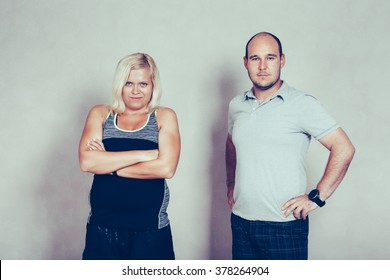 Portrait of confident sporty corpulent couple.