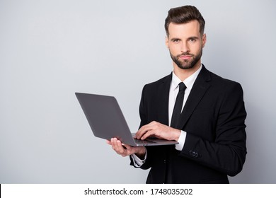 Portrait of confident successful entrepreneur man use laptop work on start-up project chat with clients partners wear formalwear clothing isolated over grey color background