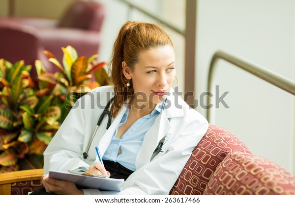 Portrait of a confident woman doctor sitting in her office relaxing having a midday break from busy schedule