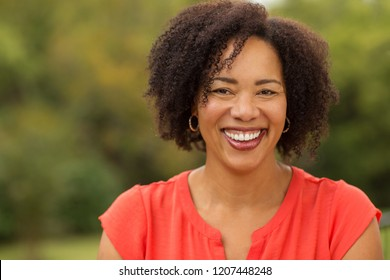 Portrait of a confident woman smiling.
