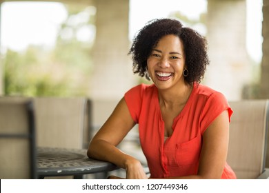 Portrait of a confident woman smiling.