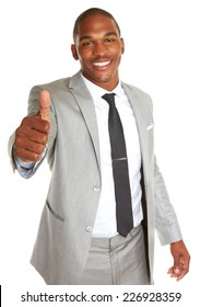 Portrait of confident young African American businessman gesturing thumbs up over white background