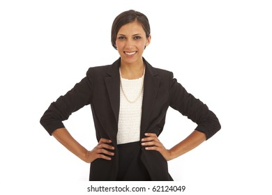 Portrait of confident young business woman with hands on hips