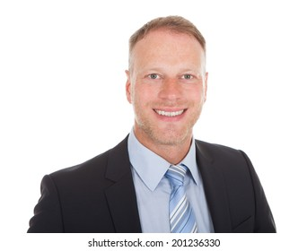 Portrait of confident young businessman smiling over white background