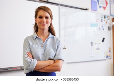Portrait of confident young Caucasian female teacher