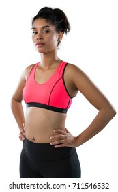 Portrait of confident young female athlete standing against white background