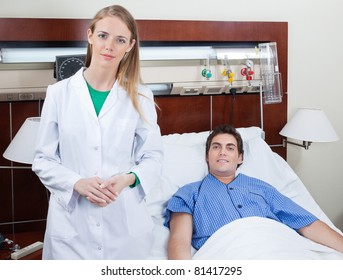 Portrait of confident young female doctor with patient in hospital