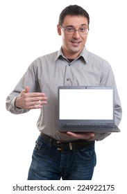 portrait of confident young man advertising laptop against white background
