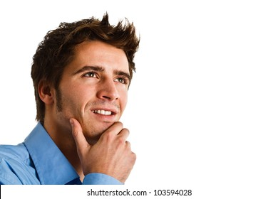 Portrait of an confident young man looking up