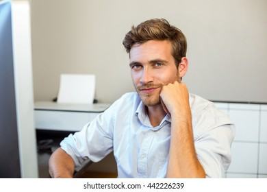 Portrait of confident young man working in office