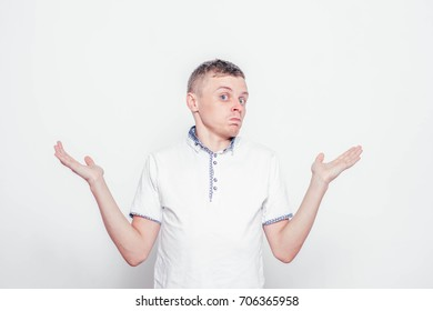 Portrait of confused technician giving I dont know gesture on white background