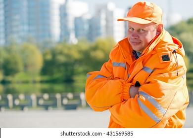 Portrait construction man worker or city yardman landscaper on town background