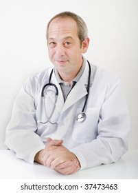 portrait of a content doctor isolated on white