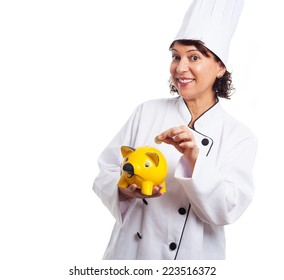 portrait of a cook mature woman inserting coin in a piggy bank