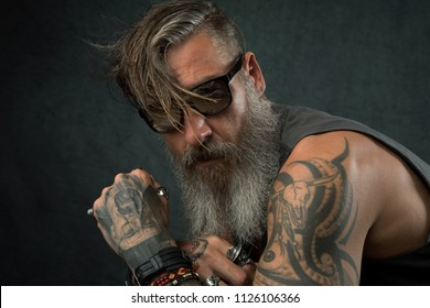 Portrait of a cool biker with sunglasses