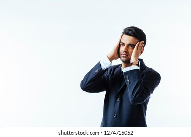 Portrait of a cool businessman holding his head in disbelief or in pain, isolated on white background