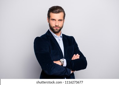 Portrait of cool handsome attractive virile masculine elegant classy elegant stunning dressed in dark blue velvet blazer checkered shirt standing with crossed arms isolated gray background copy-space
