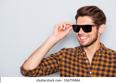 Portrait of cool happy young man wearing glasses