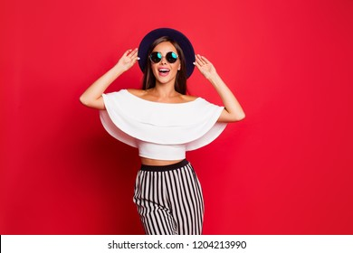 Portrait of cool shine elegant charming adorable straight-haired lady wearing white off-the-shoulders top modern look outfit wide pants isolated over pastel red background